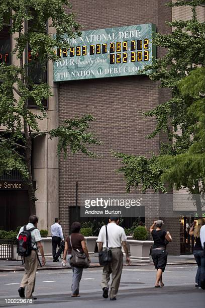 The National Debt Clock a billboardsize digital display showing the increasing US debt is seen on the corner of Sixth Avenue and West 44th Street on...