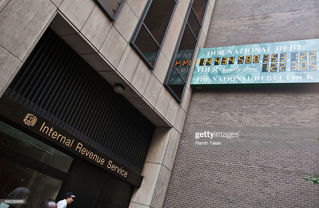 The National Debt Clock billboard is displayed next to an Internal Review Service office in midtown Manhattan on August 2 2011 in the New York City...