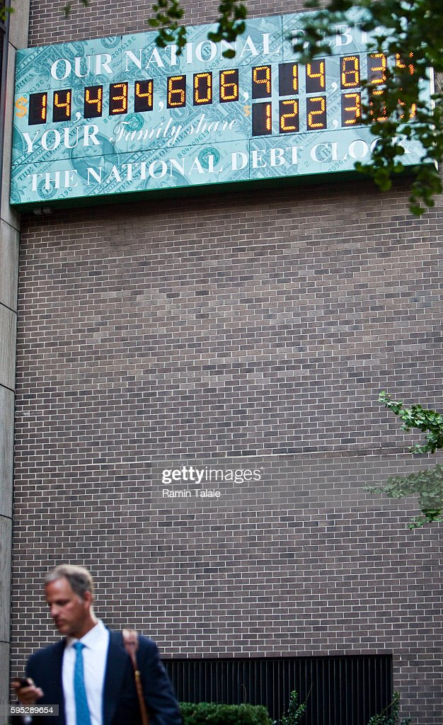 The National Debt Clock billboard is displayed on a building in midtown Manhattan on August 2 2011 in the New York City The national debt exceeds...