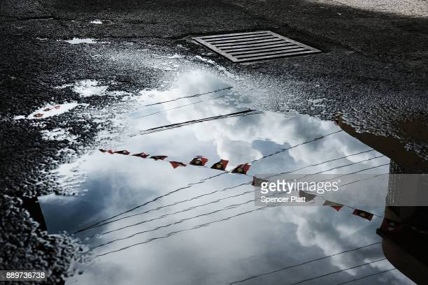 The national flag is reflected in a puddle on December 10 2017 in St John's Antiqua While it's sister island Barbuda was nearly destroyed in...