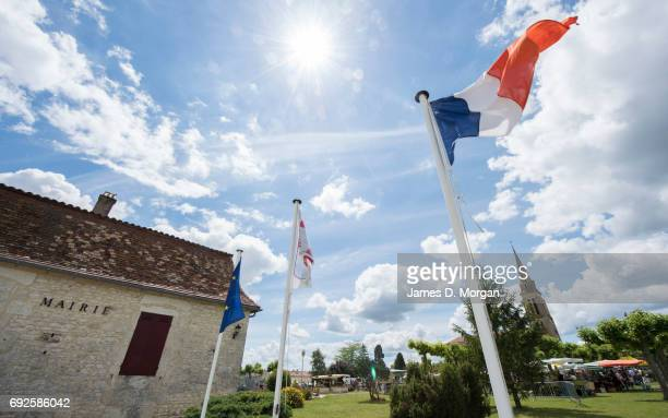 The national flag of France flies outside the local 'Marie' at a local fair on June 5 2017 in Saussignac France Monday is a public holiday in France...