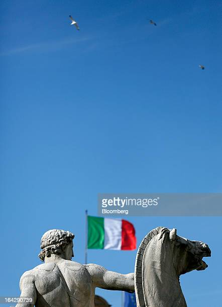 The national flag of Italy flies outside of the Quirinale Palace during a news conference with Pier Luigi Bersani leader of Italy's Democratic Party...