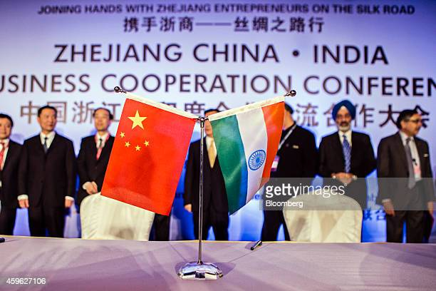 The national flags of China left and India sit on a desk during a signing ceremony at the IndiaChina Business Cooperation Conference in New Delhi...