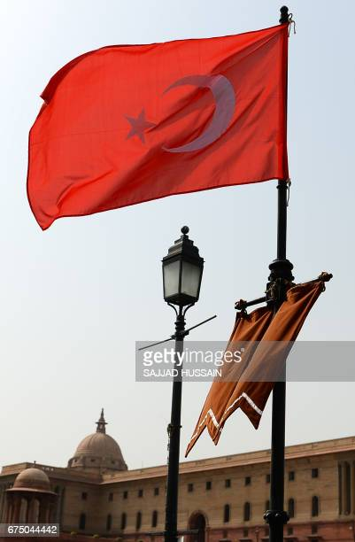 The national flags of India and Turkey fly on Rajpath ahead of an official visit by Turkish President Recep Tayyip Erdogan in New Delhi on April 30...