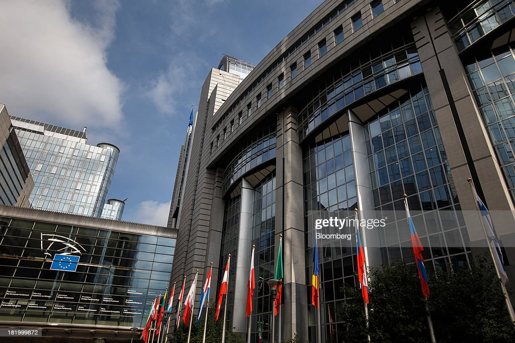 The national flags of the member states hang outside the European Union (EU) parliament building in Brussels, Belgium, on Thursday, Sept. 26, 2013. The U.K. challenged European Union caps on banker bonuses at the bloc's highest court, marking its third court battle against the EU as the region overhauls its financial rules. Photographer: Jasper Juinen/Bloomberg via Getty Images