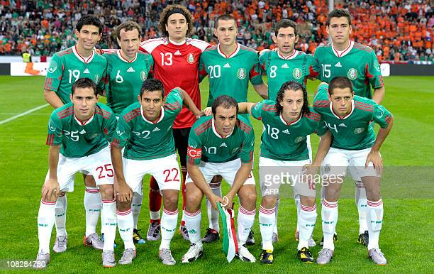 The national football team of Mexico poses for a group photo prior to a friendly football game between the Netherlands and Mexico at the Badenova...