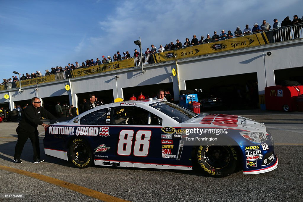 The #88 National Guard Chevrolet, driven by Dale Earnhardt Jr., is brought to the garage after practice for the NASCAR Sprint Cup Series Sprint Unlimited at Daytona International Speedway on February 15, 2013 in Daytona Beach, Florida.