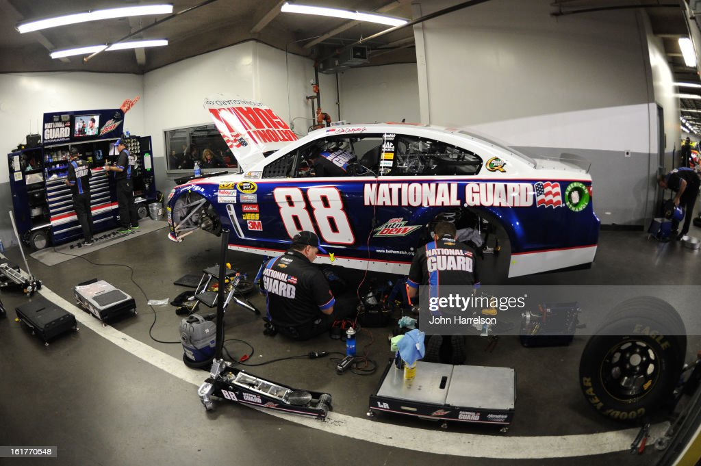 The #88 National Guard Chevrolet, driven by Dale Earnhardt Jr. is worked on after practice for the NASCAR Sprint Cup Series Sprint Unlimited at Daytona International Speedway on February 15, 2013 in Daytona Beach, Florida.