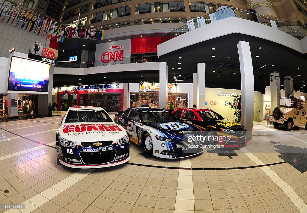 The #88 National Guard Chevrolet , the #2 Miller Lite Ford, and the #15 5 Hour Energy Toyota (L-R) are shown on display the CNN Center during the Road to Daytona Fueled By Sunoco Tour on February 11, 2013 in Atlanta, Georgia.