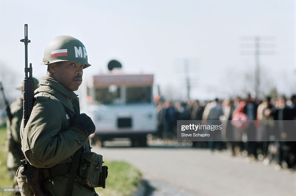 The National Guard lines the route of the civil rights march from Selma to Montgomery to protest denial of voting rights to African Americans.