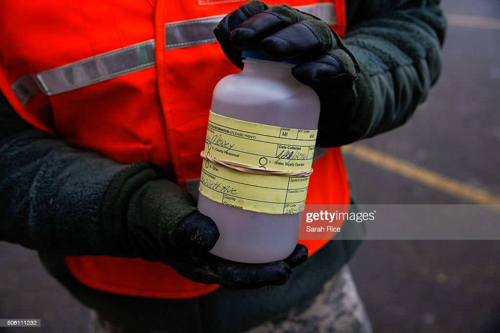 The National Guard receive water samples from residents at a fire station January 21 2016 in Flint Michigan The city's water supply hd been...
