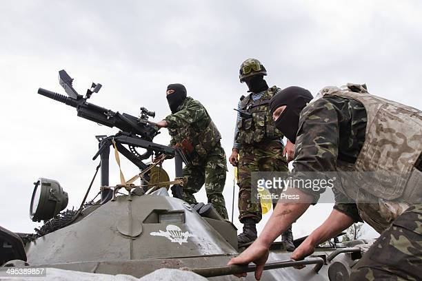 The National Guard soldiers shoot the grenade launcher during their fight with the ProUkraine separatists that threatens the country's territorial...