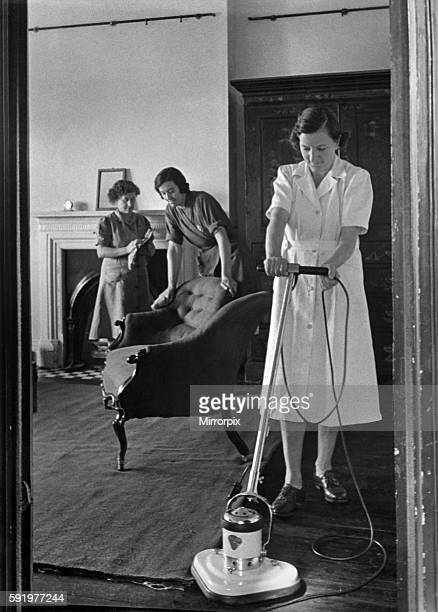 The National Institute of Houseworkers Electric floor polisher being demonstrated September 1947 P009134