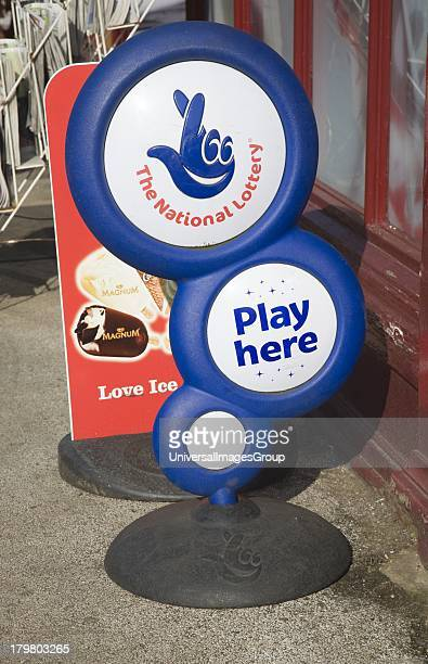 The National Lottery Play Here sign outside a shop UK