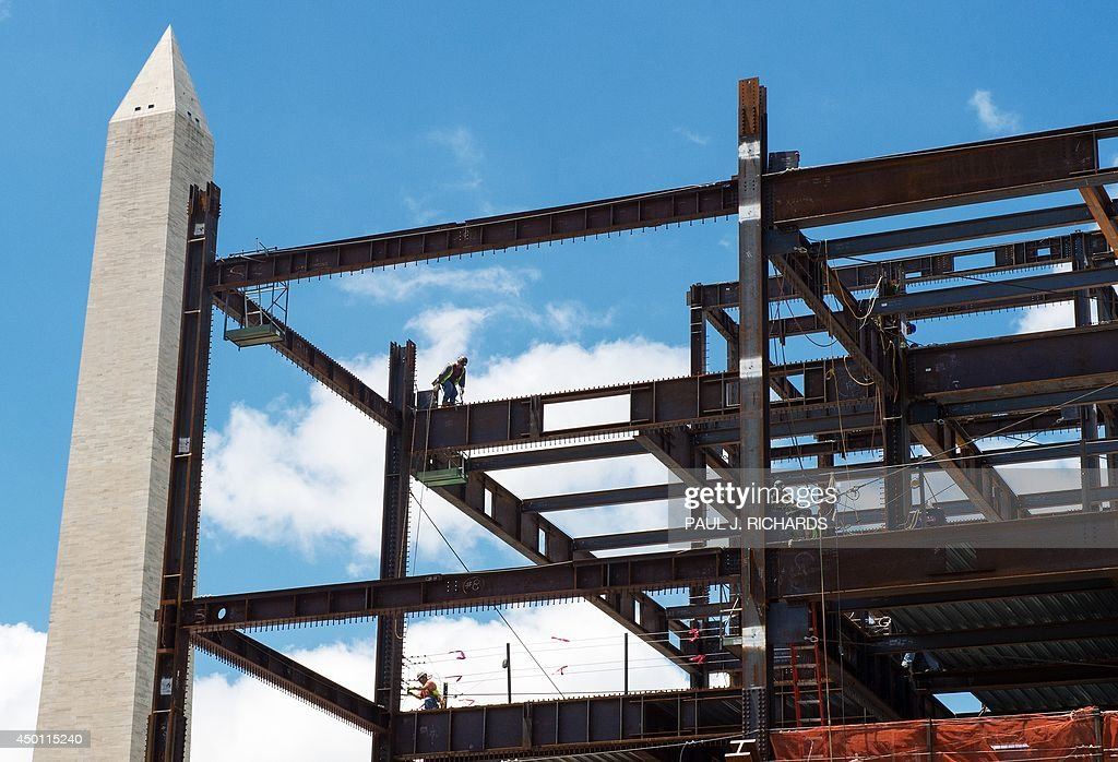 The National Museum of African American History and Culture is seen under construction June 5, 2014 on the National Mall in Washington, DC, near the Washington Monument (L). AFP PHOTO/PAUL J. RICHARDS