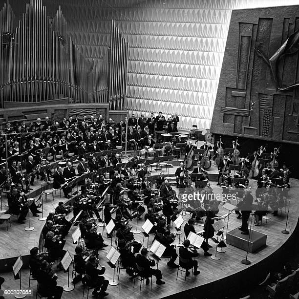 The National orchestra of the RTF supervised by Charles Munch during the inauguration of the big auditorium 104 of the Maison de la Radio