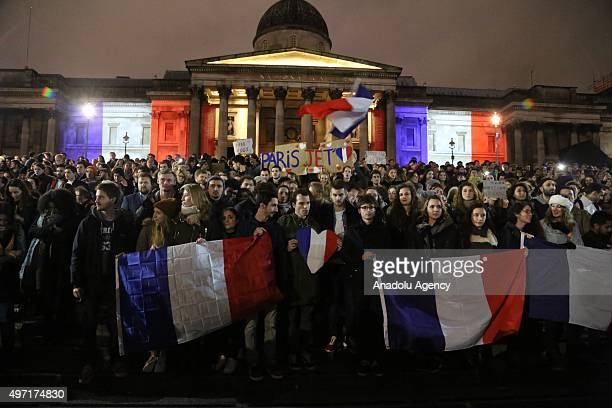 The National Portrait Gallery lit up in the colours of the French national flag during a vigil to pay respect to the victims of France terror attacks...