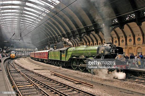 The National Railway Museum London North Eastern Railway steam locomotive 462 No 4472 'Flying Scotsman' built 1923 departing York station platform 5...