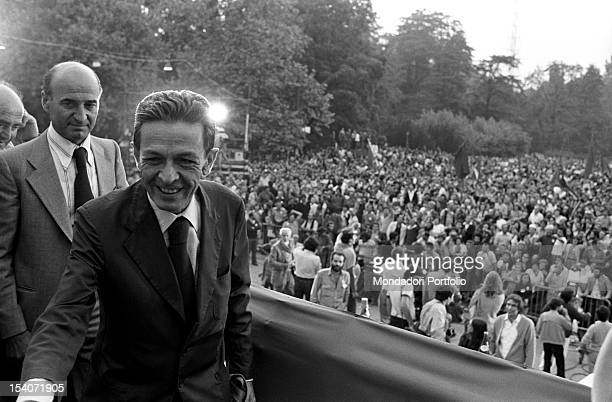 The national secretary of the Italian Communist Party Enrico Berlinguer greeting and smiling at Festa dell'Unita in Parco Sempione Milan September...