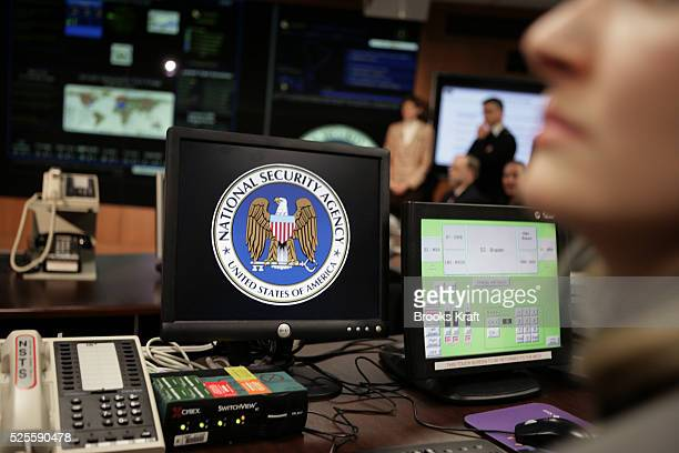 The National Security Agency logo is shown on a computer screen inside the Threat Operations Center at the NSA in Fort Meade US President George W...