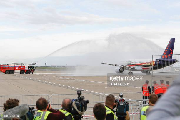 The national team plane is sprayed by firemen on the tarmac at Zaventem airport for the departure of the football team for their last qualification...