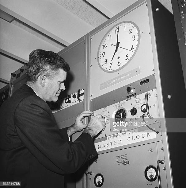 The nation's official time keepers the National Bureau of Standards and the Naval Observatory set their atomic clocks back a tenth of a second zero...