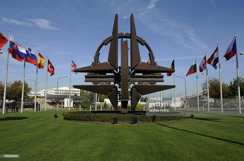 The NATO emblem is seen before a defence ministers meeting at the NATO headquarters in Brussels on October 22 2013 NATO defence ministers meet...