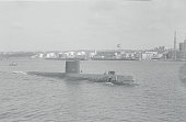 The Nautilus the world's first vessel to be propelled by atomic power heads out to sea from the Thames River for its first surface sea trial The...