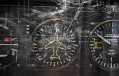 A surreal image of a fighter jets navigation dials merged with fictitious flight plans.....