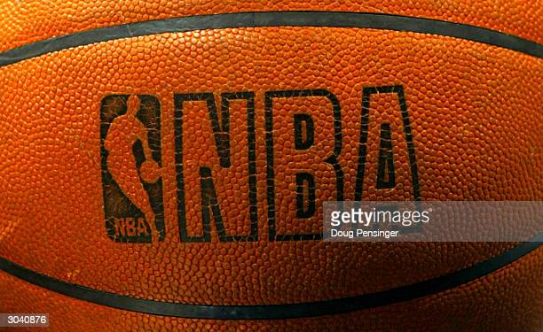 The NBA logo is shown on the game ball during the NBA game between the Toronto Raptors and the Washington Wizards on March 3 2004 at the MCI Center...