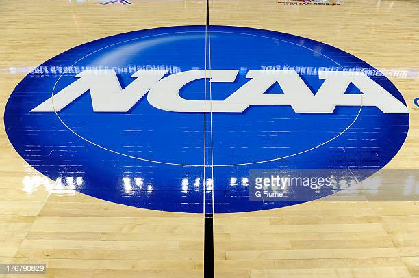 The NCAA logo on the court where the Connecticut Huskies and the Maryland Terrapins play during the East Region Sweet 16 of the NCAA Championship at...