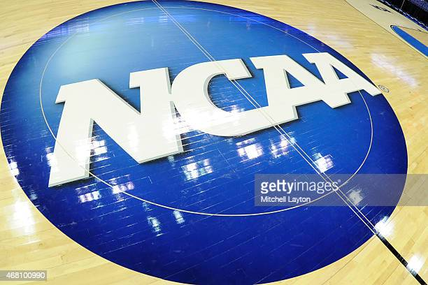 The NCAA logo on the floor before the third round of the 2015 NCAA Men's Basketball Tournament against the Dayton Flyers at the Nationwide Arena on...