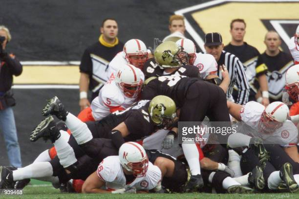 The Nebraska Cornhuskers defense try to stuff a run play during the Big 12 Conference football game against the Colorado Buffaloes on November 23...