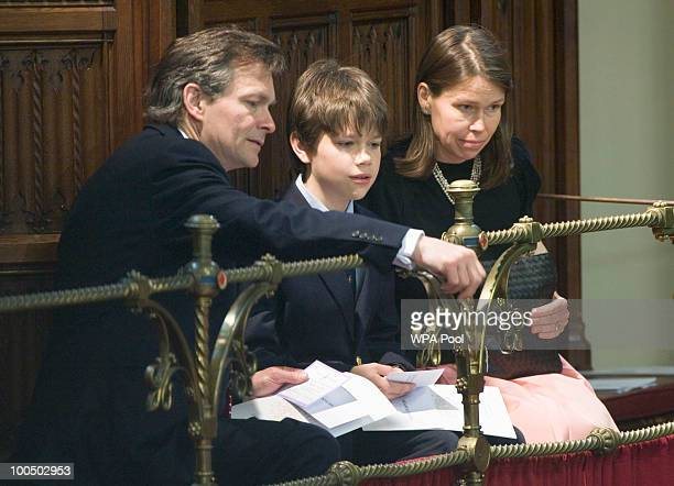 The neice of Queen Elizabeth II Sarah Chatto with husband Daniel Chatto and son Arthur Chatto look on in the House of Lords in the Palace of...