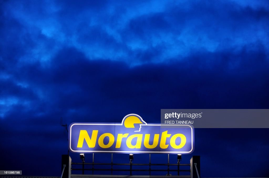 The neon sign of a Norauto car repairs and accessories's store is pictured February 11, 2013 in Brest, western of France.