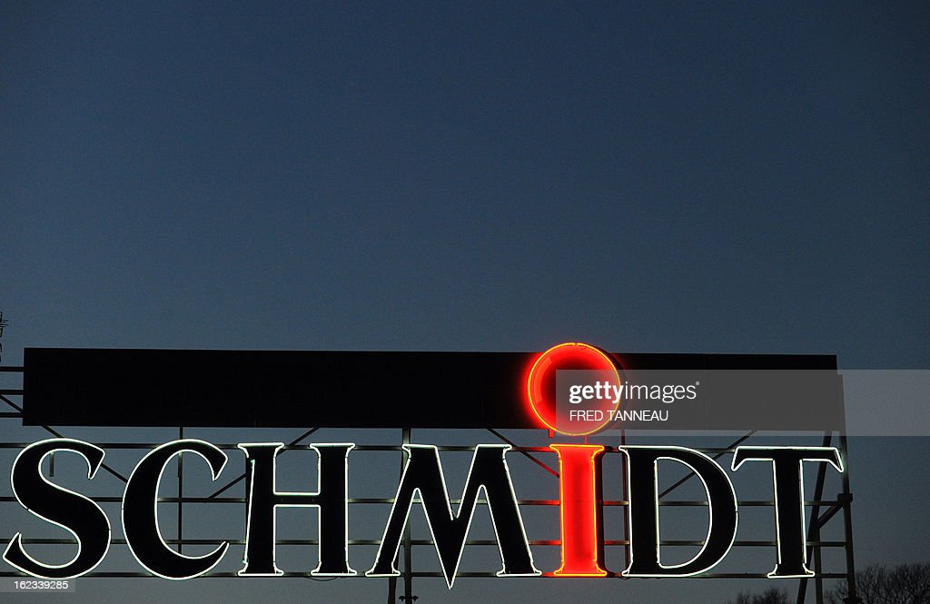 The neon sign of a Schmidt kitchen and accessories' store is pictured February 21, 2013 in Douarnenez, western of France.
