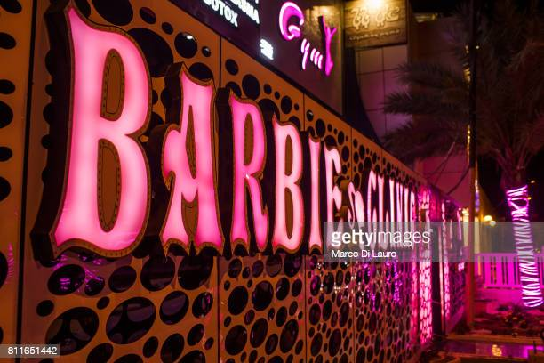 The neon sign of the Barbie Clinic is seen outside the clinic building on April 20 2015 in Baghdad Iraq 'nThe Barbie Clinic was open in 2014 by...