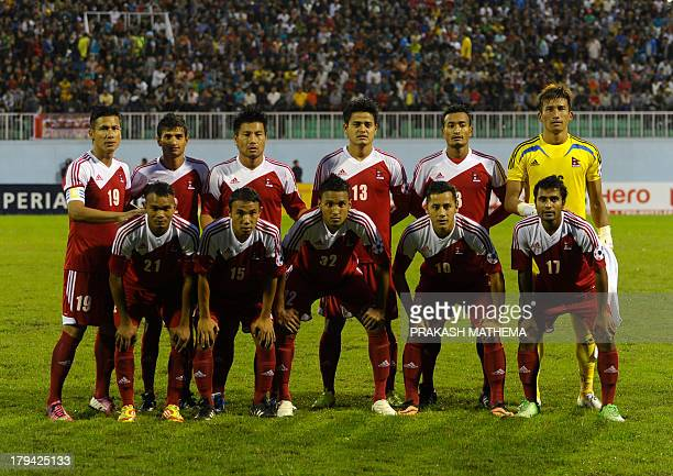 The Nepalese football team poses for a group picture before their SAFF Championship football match against Pakistan in Kathmandu on September 3...