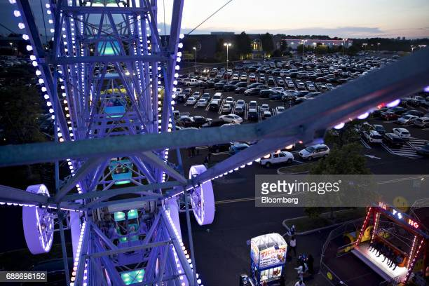 The Neshaminy Mall and parking lot stands past the Dream Wheel ride during the Dreamland Amusements carnival in Bensalem Pennsylvania US on Saturday...