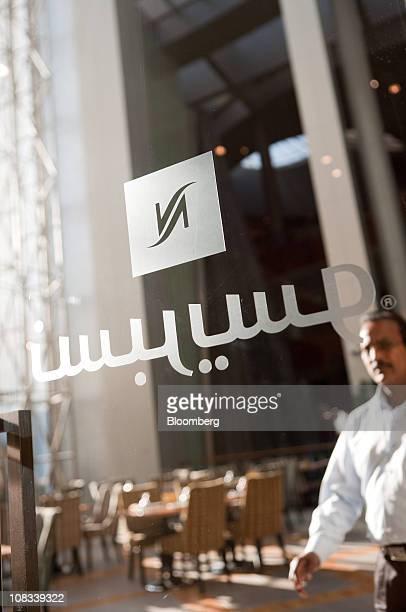 The Nespresso logo is seen on the door of a Nestle SA Nespresso boutique at Dubai Mall Dubai United Arab Emirates on Tuesday Jan 25 2011 Nespresso's...