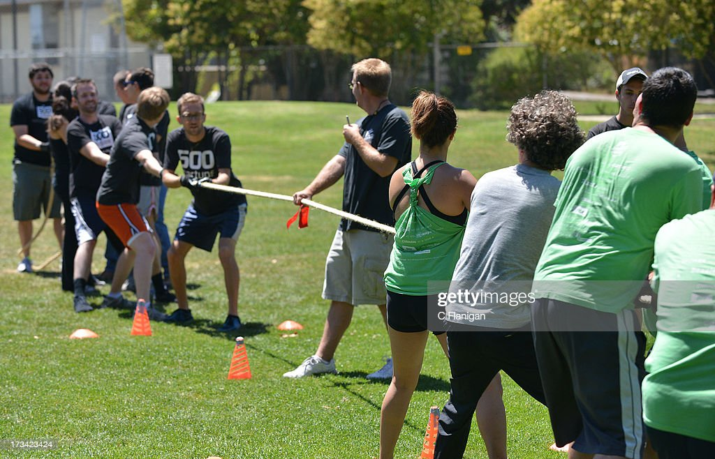 The nestGSV team vs. The 500 Startup Team during the Tug-a-War game at the Founder Institute's Silicon Valley Sports League event on July 13, 2013 in Palo Alto, California.