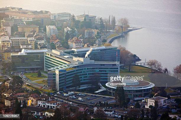 The Nestle SA headquarters center stand in Vevey Switzerland on Thursday Feb 17 2011 Nestle SA the world's largest food company reported 2010 sales...
