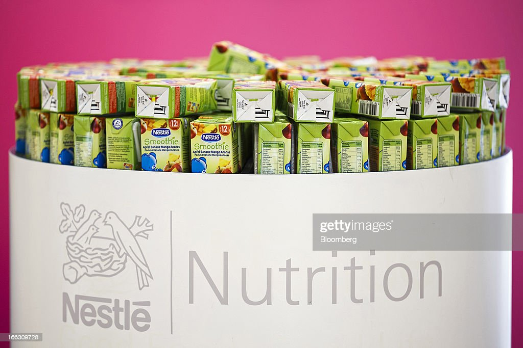 The Nestle SA logo sits on a cabinet of smoothie drinks displayed ahead of the company's annual general meeting (AGM) in Lausanne, Switzerland, on Thursday, April 11, 2012. Nestle SA's chairman said Switzerland is becoming more difficult as a business location after voters last month approved some of the world's toughest limits on executives' pay. Photographer: Valentin Flauraud/Bloomberg via Getty Images