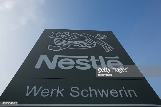 The Nestle SA logo sits on a sign outside the Nescafe Dolce Gusto coffee factory in Schwerin Germany on Thursday Oct 16 2014 The factory one of...