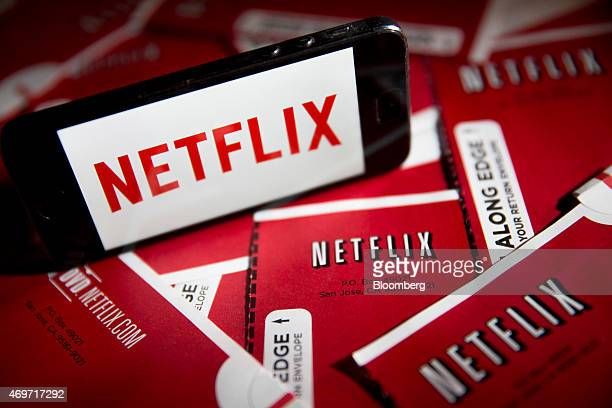 The Netflix Inc logo is displayed on an Apple Inc iPhone 5s surrounded by DVD mailers in this arranged photograph in Washington DC US on Tuesday...