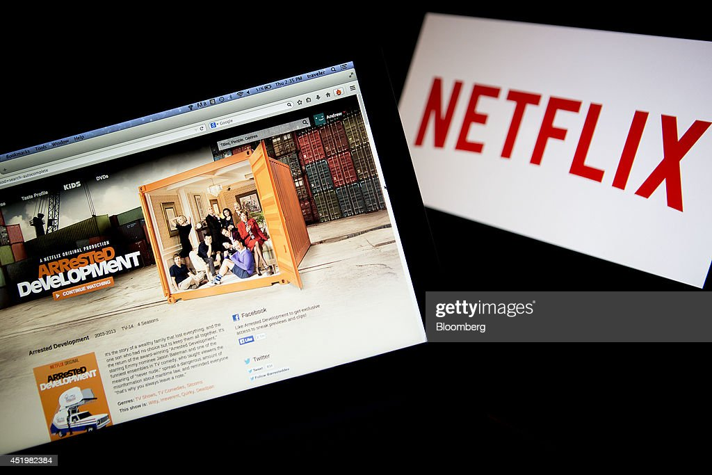 The Netflix Inc. website displays the 'Arrested Development' series on a laptop computer in this arranged photograph in Washington, D.C., U.S., on Thursday, July 10, 2014. 'House of Cards,' and 'Orange Is the New Black,' two Netflix Inc. series that have boosted the popularity of online viewing, will compete for television's top honors as nominees for Emmy awards in drama and comedy. Photographer: Andrew Harrer/Bloomberg via Getty Images