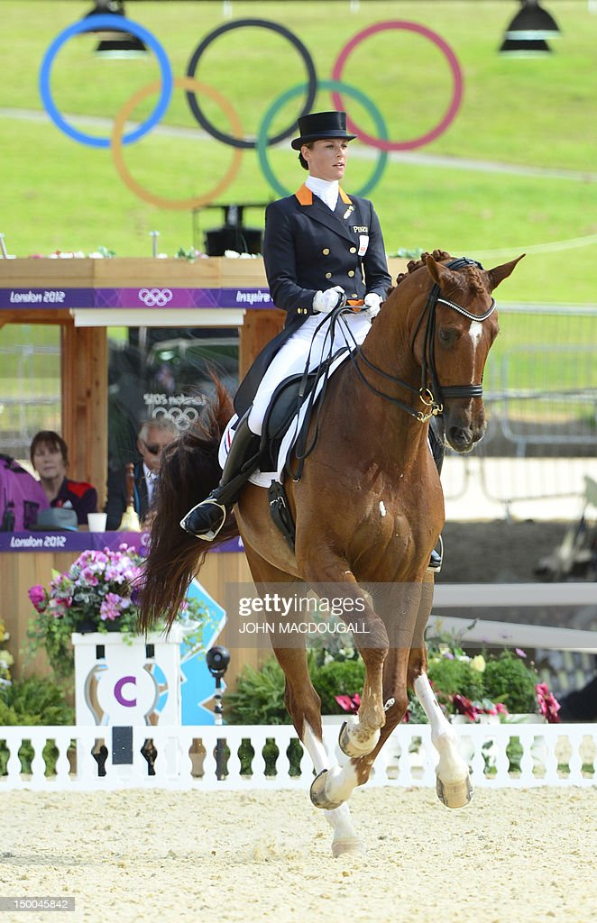 The Netherlands' <a gi-track='captionPersonalityLinkClicked' href=/galleries/search?phrase=Adelinde+Cornelissen&family=editorial&specificpeople=5427385 ng-click='$event.stopPropagation()'>Adelinde Cornelissen</a> rides Parzival during the Equestrian Individual Dressage competition at Greenwich Park during the London 2012 Olympic Games in London on August 9, 2012.