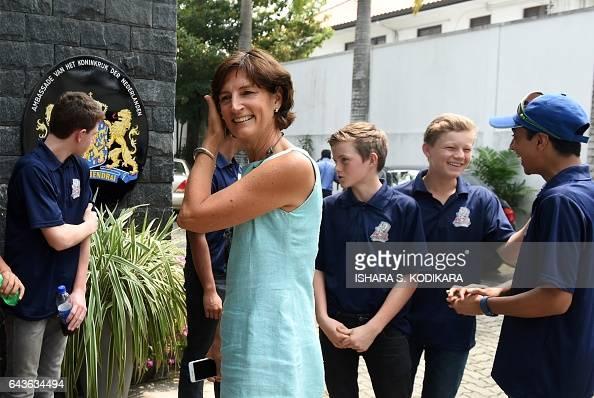 The Netherlands' ambassador to Sri Lanka Joanne Doornewaard hosts a visiting Dutch school cricket team in Colombo on February 22 2017 The Amsterdam...