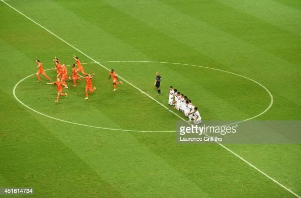 The Netherlands celebrate after defeating Costa Rica in a penalty shootout during the 2014 FIFA World Cup Brazil Quarter Final match between the...
