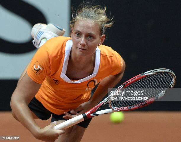 The Netherlands' Cindy Burger returns the ball during a training session for the Federation Cup World Group second round semi final tennis match...